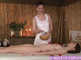 Hot lesbians oiled up - Oiled up lesbian beauties on a massage table
