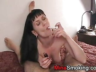 Guys swap during blowjob Housewife smoking a cigarette during blowjob for husband
