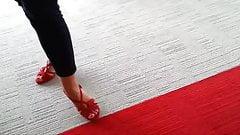 Friend's feet in red heels 1