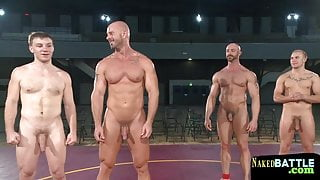 Muscly studs wrestling in front of audience
