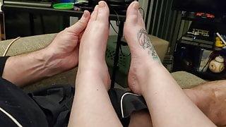 Husband rubbing my lotion on my feet