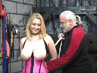 Slut hung from her neck - Lillith gets nipple torture with dom pinching and collar around her neck