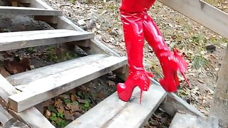 Lady L walking with red extreme sexy boots.