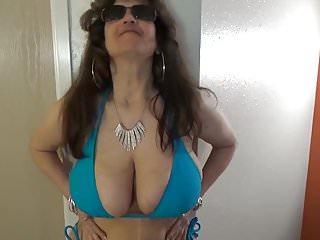 String bikini germany Tinja stretches a blue string bikini