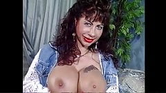Gina Colany teases and double dildos.