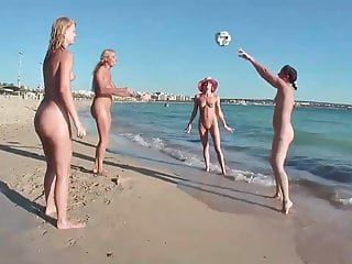 Nude women flashing breast - Nude women on beach