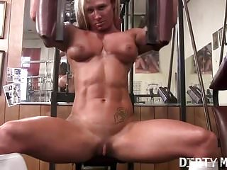 Naked female photography - Naked female bodybuilder tattooed muscular in the gym