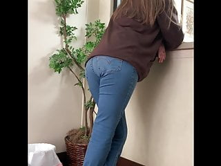 Sexy lady in jeans tattoo Leggy young lady in tight jeans bent over counter