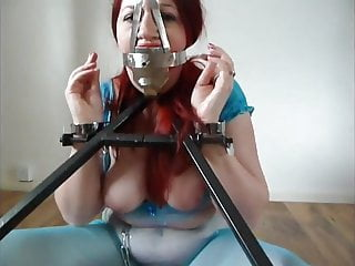 Metal door bottom Slave in metal frame and scolds bridle