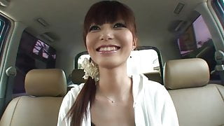 Fresh faced brunette masturbates in the back seat of a car