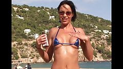 Hot beach babe in micro bikini