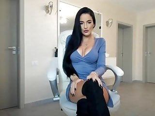 Very big breast enlargement Very beautiful girl in boots with beautiful breasts