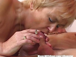 Mama sucks cock Mature blonde mama sucks young cock while smoking