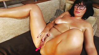 A brunette with a good figure caresses her horny pussy