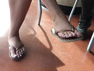 Teen flip flop thumbs - Candid beautiful toes feet in flip flops close up