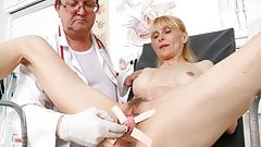 Slim mature woman's pussy check-up