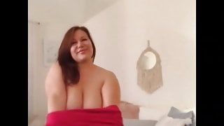 Mal Malloy tries on red dress