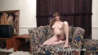 Dani models her natural body while naked