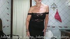 Seductive Lukerya in a little black dress and stockings
