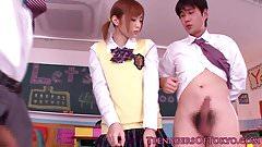 Asian teen schoolgirl giving handjob in class