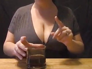 Breast flashing her - Mother expresses breast milk into coffee