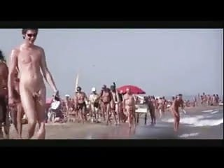 Outdoor male pleasure Hot shaved naked male nudist walks on beach