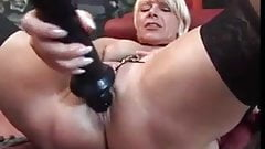 Booted German Mature Beauty playing with her cunt