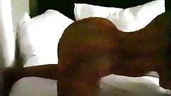 Nicki Minaj twerking on a bed in a transparent dress