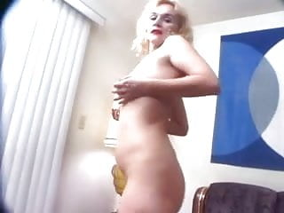 Busty and brassy - Brassy blonde granny puts on pantyhose toys and fucks