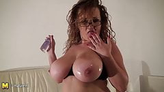 Big breasted mature slut oiling up herself