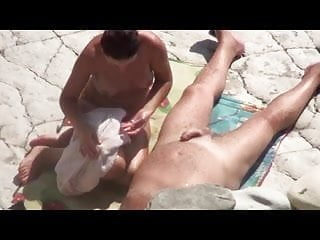 College guy jerks off - Girl does a guy jerks off dick on a public beach