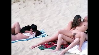 Group sex on a German beach, upscaled to 4K