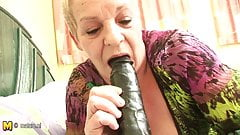Dirty European granny playing with her toy