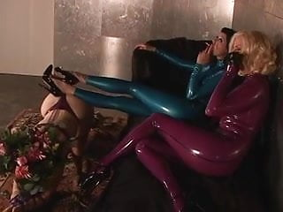 Latex suite Slut in blue latex suit gagged and bound