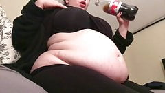 Fat feedee bloats her belly with soda
