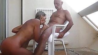 Mature couple fucks on the terrace
