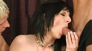 Brunette rides guy's tool while he sucks another dude's dick