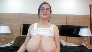 Nerdy Latina with glasses shows her gigantic boobs on cam