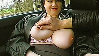 A very busty amateur Milf toying and fingering in a car