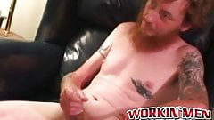 Bearded tattooed mature guy jerks off and cums on himself