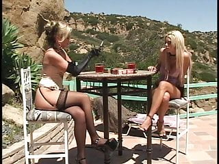 Chicks using dildos - Lesbian chicks using a strap-on outdoors