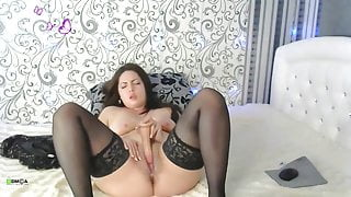 Girl develops her ass by sticking a dildo in it