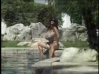 Huge bikini tubes Huge heavy tits on a beautiful lady next to the pool