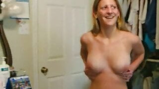 Shy blonde strips to show her body and bush