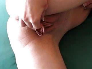 Labia of the pussy Stretching her long pussy lips labia