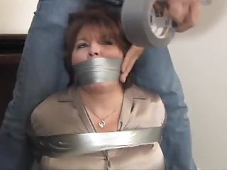 Taped up and fucked Two milfs taped up in the office