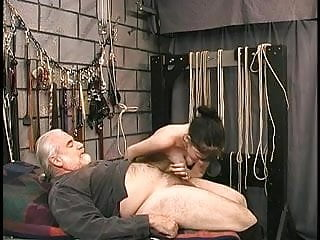 Free bdsm torture videos - Young brunette bdsm torture victim is made to suck off master lens dick