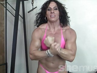 Chubby posing woman Mature female bodybuilder poses and flexes