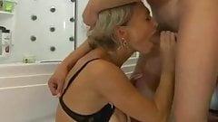 Stunning mature women and boy in shower
