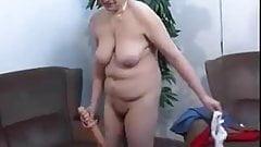 Chubby mature skank slams her hairy vag with a dildo